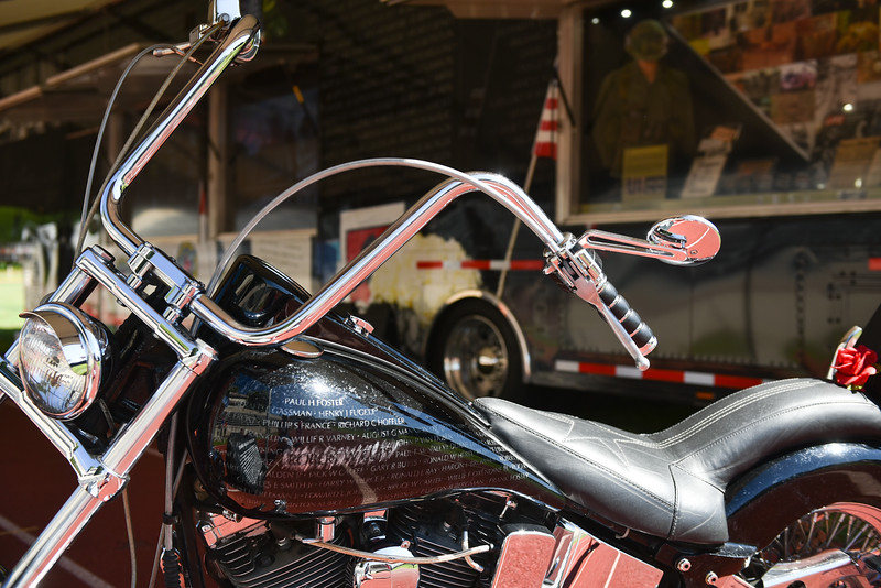 "The ""Gold Star Bike"" is on display in front of the walls trailer during a ceremony on Thursday at Crocker Field in Fitchburg commemorating ""The Wall That Heals.""  SENTINEL & ENTERPRISE JEFF PORTER"
