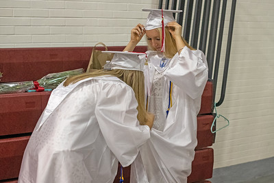 Colleen Garrigan (left) helps Grace Abrecht zip her gown before Wall High School held their Commencement Exercises for the Class of 2019 in their gymnasium on Thursday June 20, 2019. [ALYSSA RASP | THE COAST STAR]