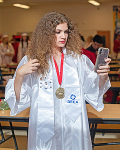 Kayden Hallett fixes her hair in her phone camera before Wall High School held their Commencement Exercises for the Class of 2019 in their gymnasium on Thursday June 20, 2019. [ALYSSA RASP | THE COAST STAR]