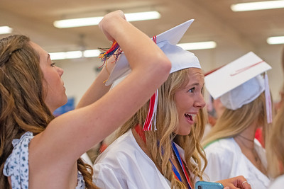 Taylor Popola gets a little help with her mortarboard from a friend before Wall High School held their Commencement Exercises for the Class of 2019 in their gymnasium on Thursday June 20, 2019. [ALYSSA RASP | THE COAST STAR]