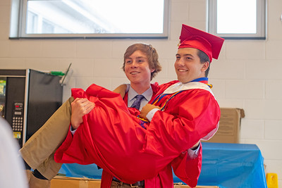 Devon Hemmer (left) lifts Aidan Newbury as they pose for a photo before Wall High School held their Commencement Exercises for the Class of 2019 in their gymnasium on Thursday June 20, 2019. [ALYSSA RASP | THE COAST STAR]