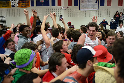 The Wall Township Boy's Varsity Basketball Team and fans celebrating their 53-47 win over Burlington Township High School to become the 2019 NJSIAA Group 3 Sectional Champions at Wall High School gymnasium on 03/05/2019. (STEVE WEXLER/THE COAST STAR).