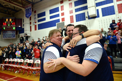 The scoreboard tells the story and the Wall Township High School Boy's Varsity Basketball Coaching staff reacts to their 53-47, 2019 NJSIAA Group 3 Sectional Championship win over Burlington Township High School at Wall High School gym on 03/05/2019. (STEVE WEXLER/THE COAST STAR).