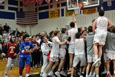 The Wall Township High School Boy's Varsity Basketball Team, the 2019 NJSIAA Group 3 Sectional Champions, celebrating with their fans, after defeating Burlington Township High School 53-47 at Wall High School gym on 03/05/2019. (STEVE WEXLER/THE COAST STAR).