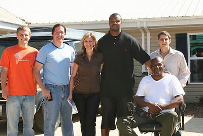 2011 03-18 Leonard Pope (middle) mets Fuller Center homeowner