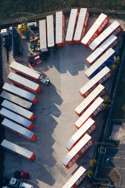aerial photo of lorries parked in a pattern at a warehouse.