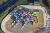 An aerial photo of a brightly coloured playground.