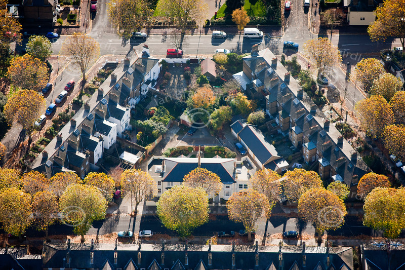 aerial photo of a triangular pattern of houses.
