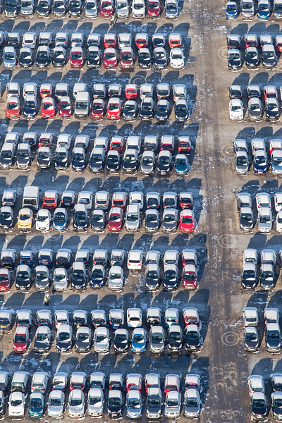 Cars in the snow from the air.