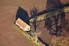 An aerial photo of an old barn.