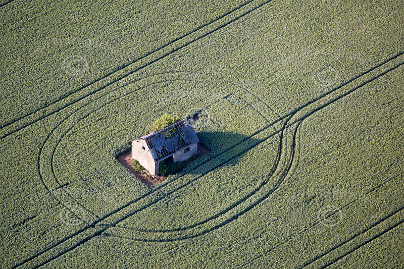 Aerial photo of an old derelict stone barn.