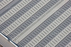 aerial photo of a pattern of factory roofs.