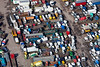 A stock aerial photo of a junk / scrap yard of lorries.