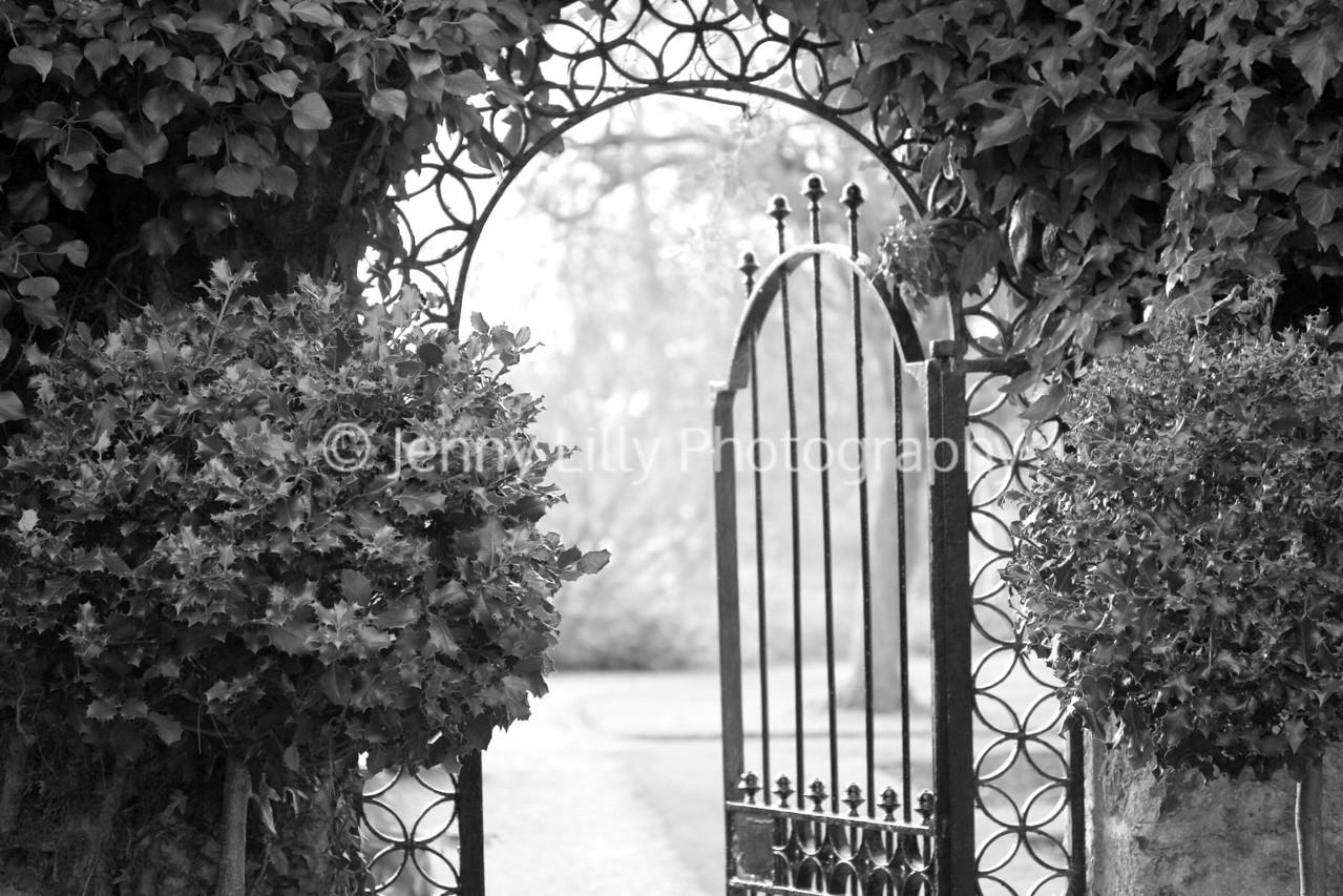 MONOCHROME VIEW THROUGH GATE AT OXFORD BOTANICAL GARDENS