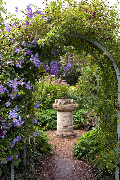 view of clematis covered pergola at Coughton Court