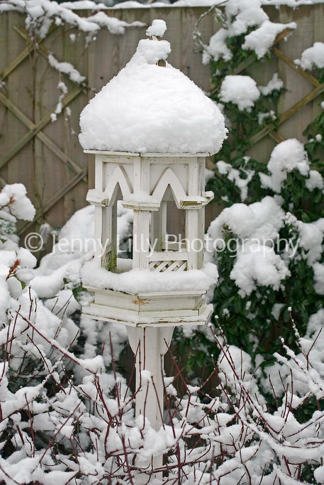 SNOW COVERED GOTHIC BIRD FEEDING STATION