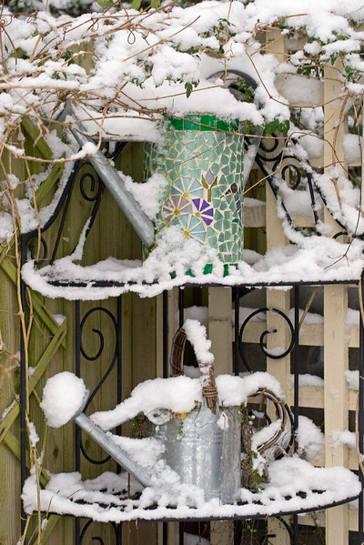 DECORATIVE WATERING CANS COVERED IN SNOW