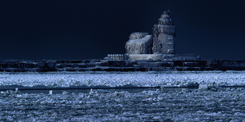 """Night shot of the Whiskey Island Lighthouse frozen in time.<br /> This photo has been cropped for a 24""""x12"""" Ready-to-Hang Float Mount Metal Print. Purchase Price: $183.99<br /> To purchase this wall mount, click on the cart button to the right."""