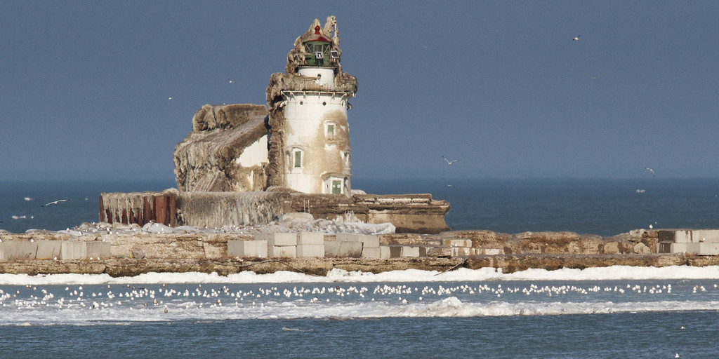 """The Whiskey Island Lighthouse thawing out from it's early winter freeze.<br /> This photo has been cropped for a 24""""x12"""" Ready-to-Hang Float Mount Metal Print. Purchase Price: $183.99<br /> To purchase this wall mount, click on the cart button to the right."""