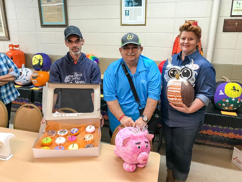 Steve Rines (middle) won first place in the pumpkin carving/decorating contest.  Mark Haynes (left) came in second and Karen Coburn (right) came in third.