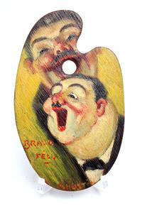Palette miniature peinte et décorée présentant deux têtes caricaturales, début du 20e siècle.
