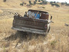 Burt's iconic indestructible 70s Chevy pickup loaded with concrete, wood, fence posts.