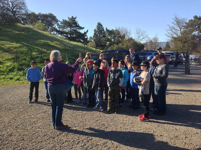 WCOSF Board member and Tuesday Group volunteer talks native grasses at Sutherland with 4th graders from Deborah Walker's science class at Buena Vista School in Walnut Creek.  (Linda herself is a former BV teacher.)