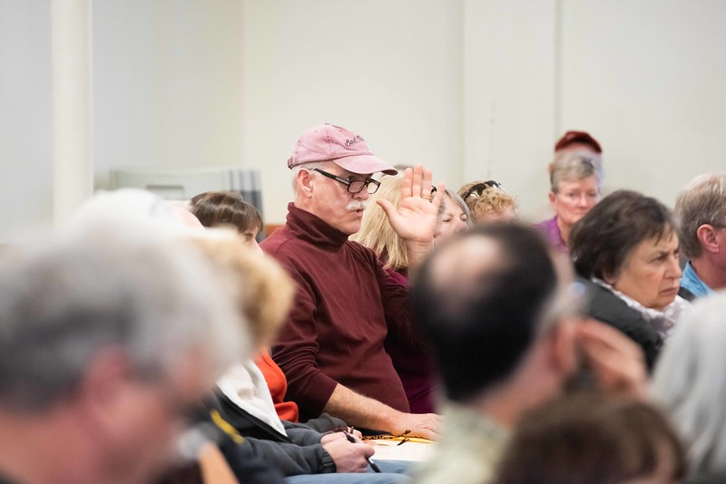 KELLY FLETCHER, REFORMER CORRESPONDENT -- Tom Aldrich poses a question at Walpole's town meeting on Saturday.