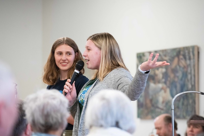 KELLY FLETCHER, REFORMER CORRESPONDENT -- Ruby Frithsen (left) and Sidney Curven anaswer questions about their proposed plastic bag ban at Walpole's town meeting on Saturday.