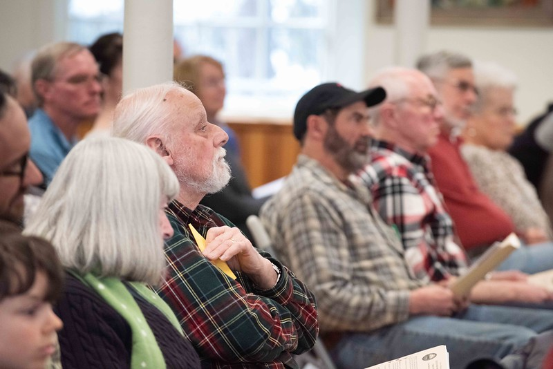 KELLY FLETCHER, REFORMER CORRESPONDENT -- Walpole residents listen to Ruby Frithsen and Sidney Curven talk about their proposed plastic bag ban.