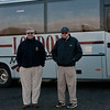 Dick Daves and David Eld wait outside the coach