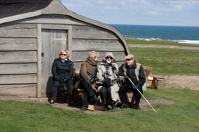 Kathy, Penelope, Janet Gill and Joe Hobson in front of upturned boat outbuilding