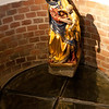 The well with the reflection of Our Lady in the cover