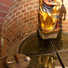 The well with bucket on ladle
