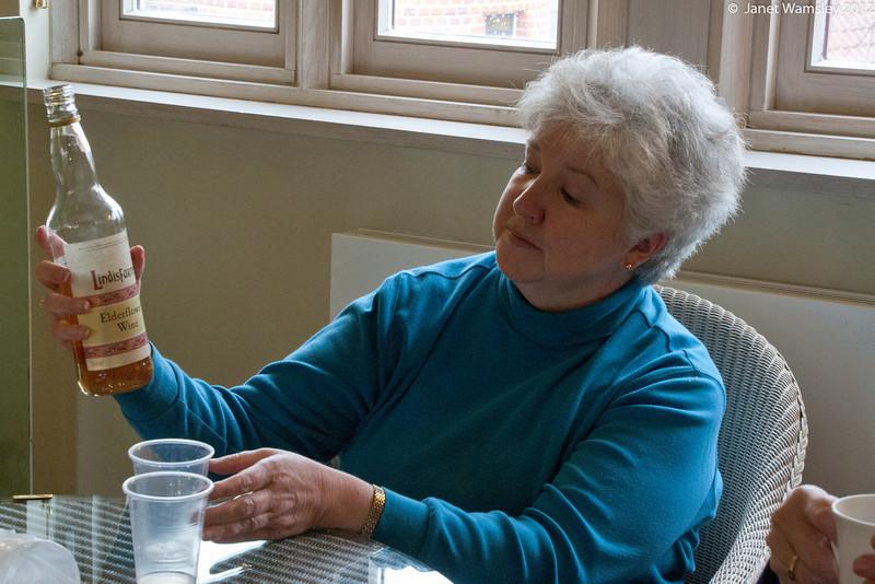 Linda Wilkinson with Lindesfarne wine
