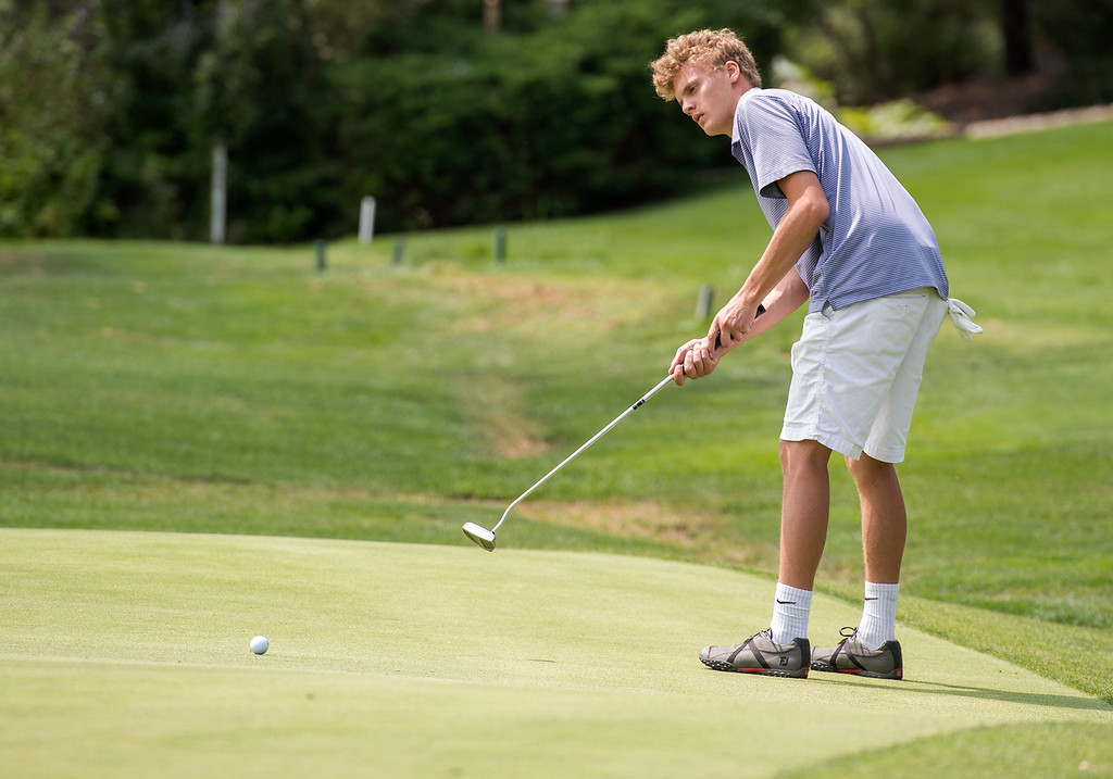 . Mountain View\'s AJ Buckner putts Wednesday afternoon during the Walt Clark Invitational at the Olde Course in Loveland. (Photo by Michael Brian/Loveland Reporter-Herald)