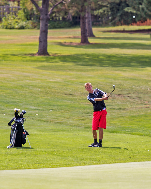 . Loveland\'s Blaine Tucker chips for the green Wednesday afternoon during the Walt Clark Invitational at the Olde Course in Loveland. (Photo by Michael Brian/Loveland Reporter-Herald)
