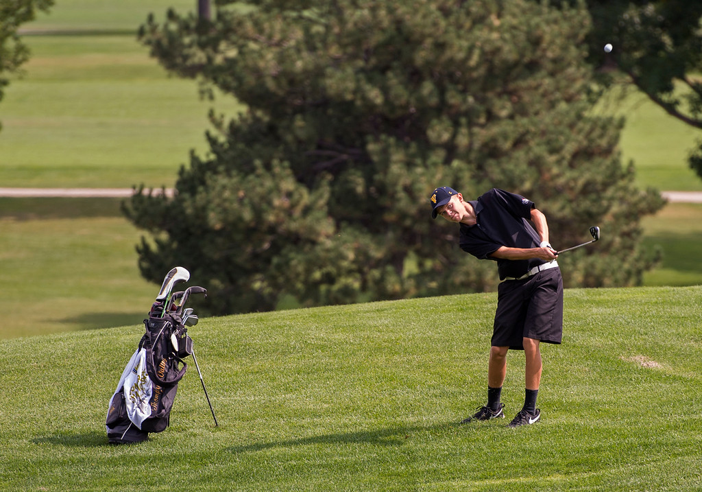 . Thompson Valley\'s Darren Edwards hit from the rough Wednesday morning during the Walt Clark Invitational at the Olde Course in Loveland. (Photo by Michael Brian/Loveland Reporter-Herald)