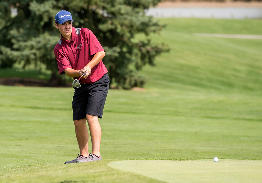 . Berthoud\'s Brogan Sontag watches his put from the fringe roll across the green Wednesday morning during the Walt Clark Invitational at the Olde Course in Loveland. (Photo by Michael Brian/Loveland Reporter-Herald)