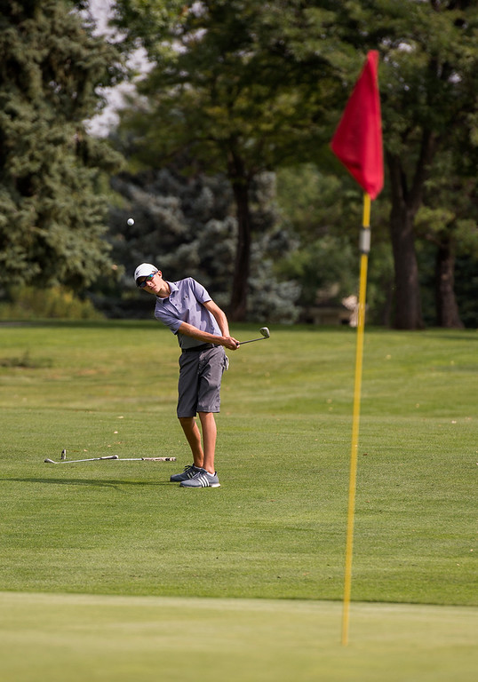 . Mountain View\'s Wes Weber chips to the green Wednesday morning during the Walt Clark Invitational at the Olde Course in Loveland. (Photo by Michael Brian/Loveland Reporter-Herald)