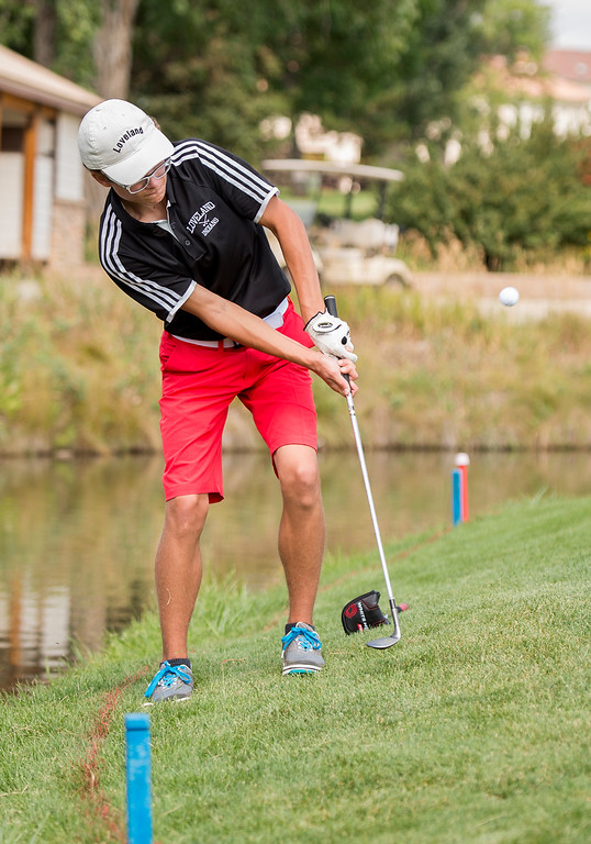 . After losing a ball in the water Loveland\'s Joseph Flock chips onto the green Wednesday morning during the Walt Clark Invitational at the Olde Course in Loveland. (Photo by Michael Brian/Loveland Reporter-Herald)