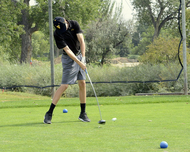 Thompson Valley's Darren Edwards connects with his tee shot on No. 13 during Thursday's Walt Clark Invitational at the Olde Course in Loveland. Edwards took medalist honors with a round of 74.
