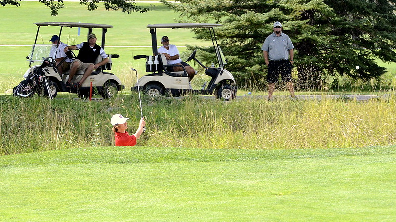 Loveland's Henry Stucky chips onto the green during Thursday's Walt Clark Invitational at the Olde Course in Loveland. Stucky tied for third with a 75.