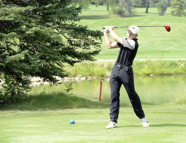 JackHummel of Berthoud tees off on the sixth hole during the Walt Clark Invitational on Thursday at the Olde Course in Loveland. Hummel led the Spartans with an 81.