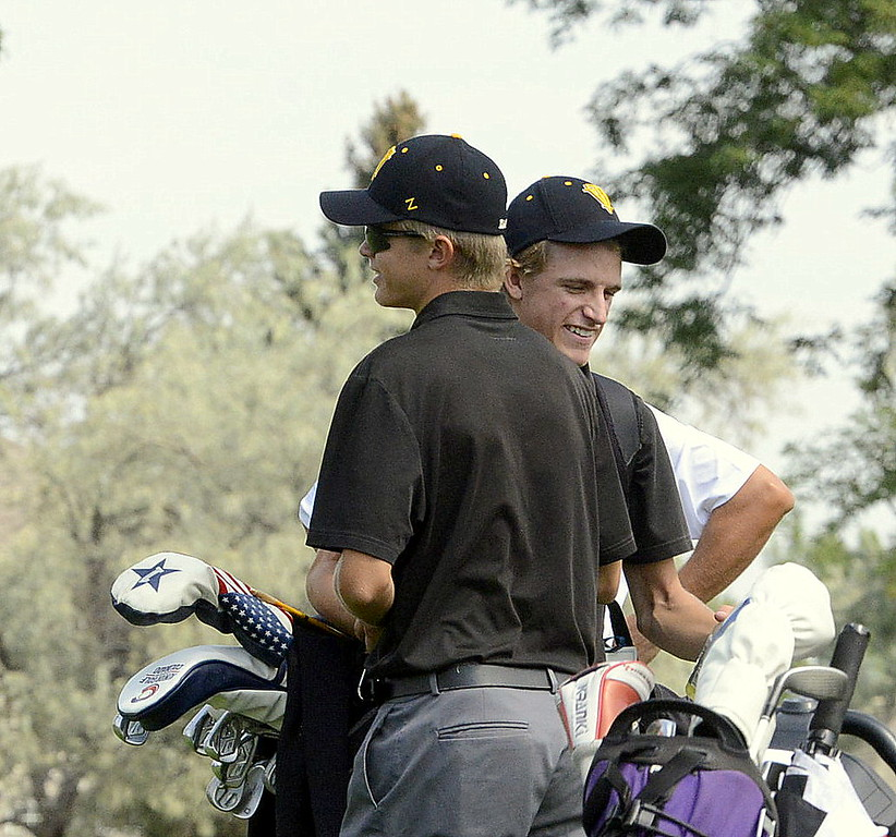 Thompson Valley teammates Darren Edwards (front) and Nate Dwyer share a laugh in between holes during Thursday's Walt Clark Invitational at the Olde Course in Loveland. Edwards shot 74, Dwyer a 79 to help the Eagles take second in the invite and win the Northern League portion of the event.