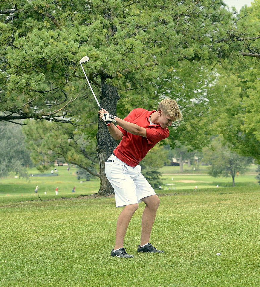 Blaine Tucker of Loveland hits his approach shot on the fifth hole of the Walt Clark Invitational on Thursday at the Olde Course in Loveland. Tucker finished at 85 for the Indians.