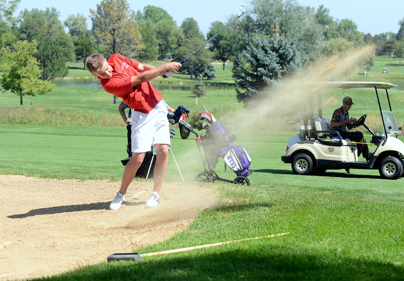 Loveland's Blaine Tucker blasts out of a fairway trap during the Walt Clark Invitational on Wednesday at the Olde Course in Loveland. (Mike Brohard/Loveland Reporter-Herald)