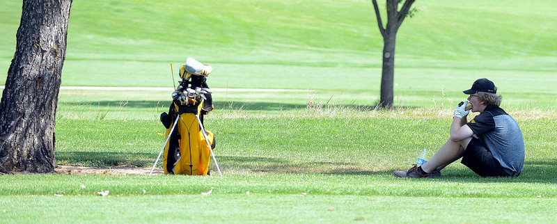 Thompson Valley's Ben Voigt grabs a bite of his sandwich during a break in the action during the Walt Clark Invitational on Wednesday at the Olde Course in Loveland. (Mike Brohard/Loveland Reporter-Herald)