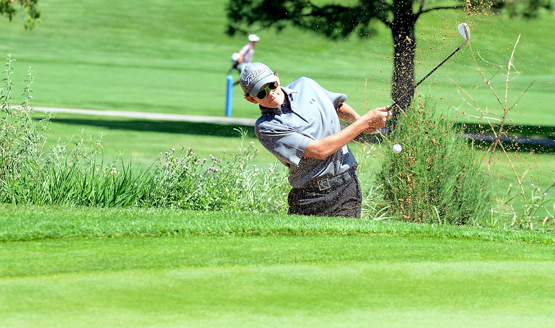 Mountain View's Drew Visocky gets out of a green-side bunker during the Walt Clark Invitational on Wednesday at the Olde Course in Loveland. (Mike Brohard/Loveland Reporter-Herald)