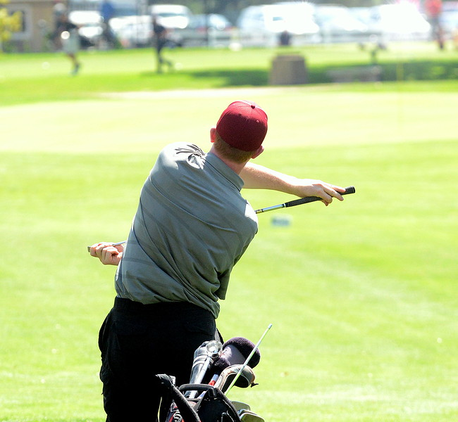 Berthoud's Ben Burkett twists around his club in an attempt to get his ball to go another direction during the Walt Clark Invitational on Wednesday at the Olde Course in Loveland. (Mike Brohard/Loveland Reporter-Herald)
